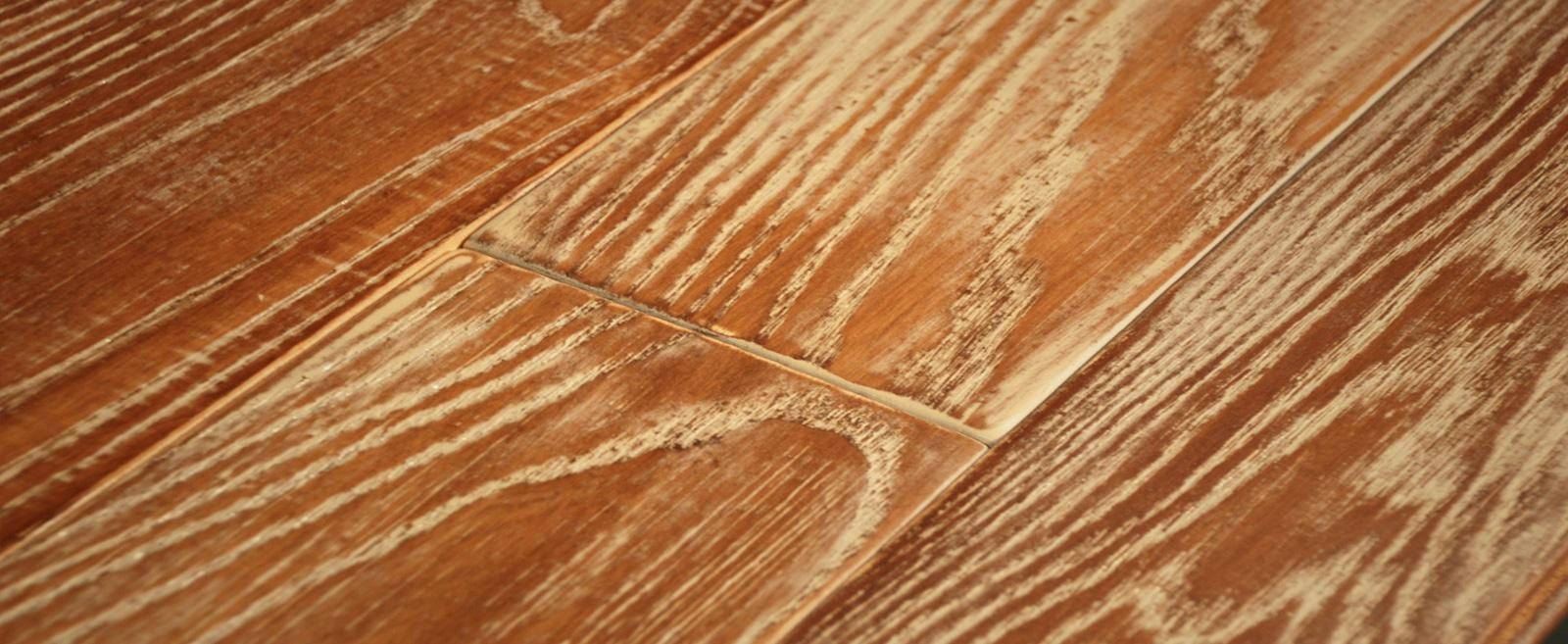 Brad Rehmeyer of Rehmeyer Floors designed this worn painted hardwood flooring