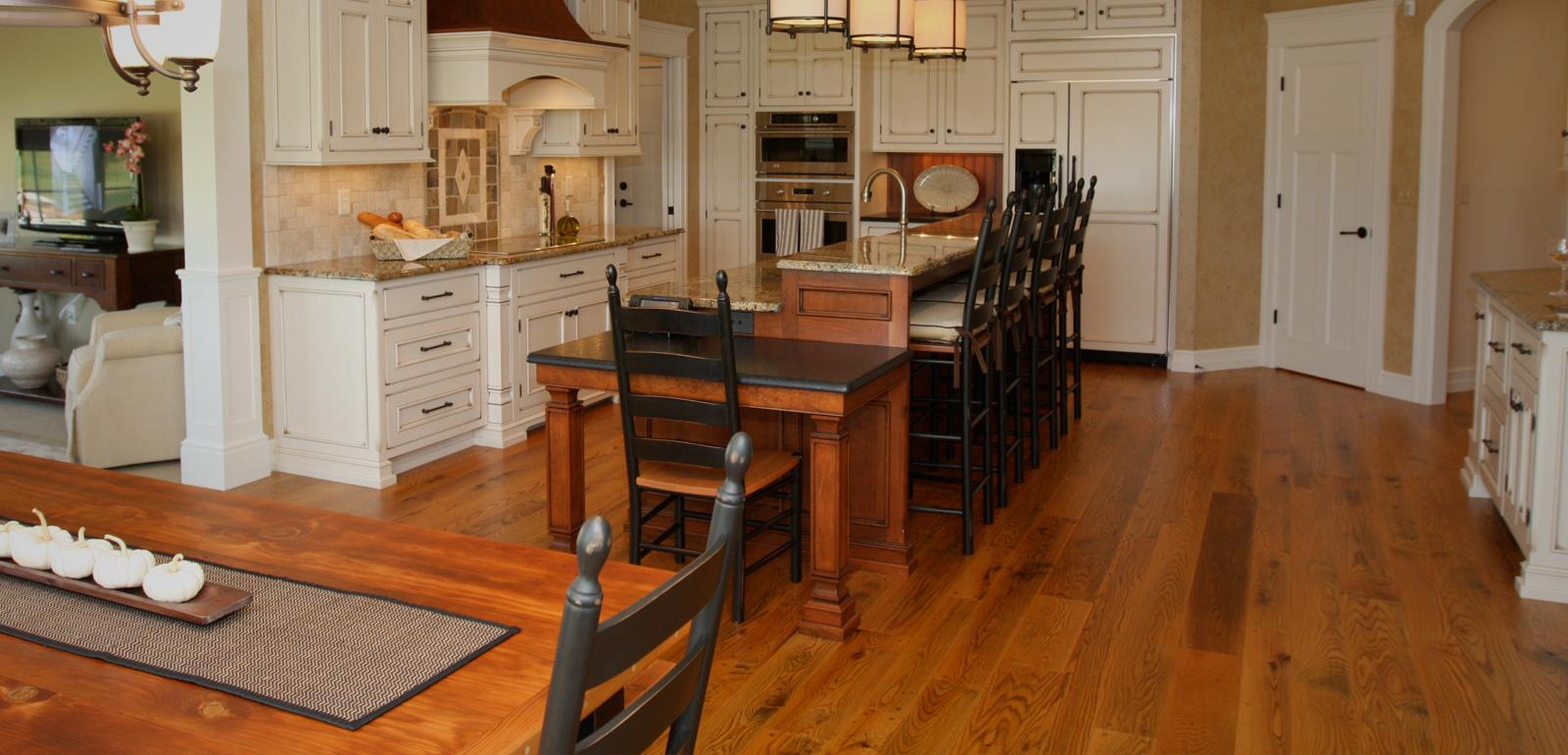 Custom flooring - white oak wide plank hardwood floor in kitchen