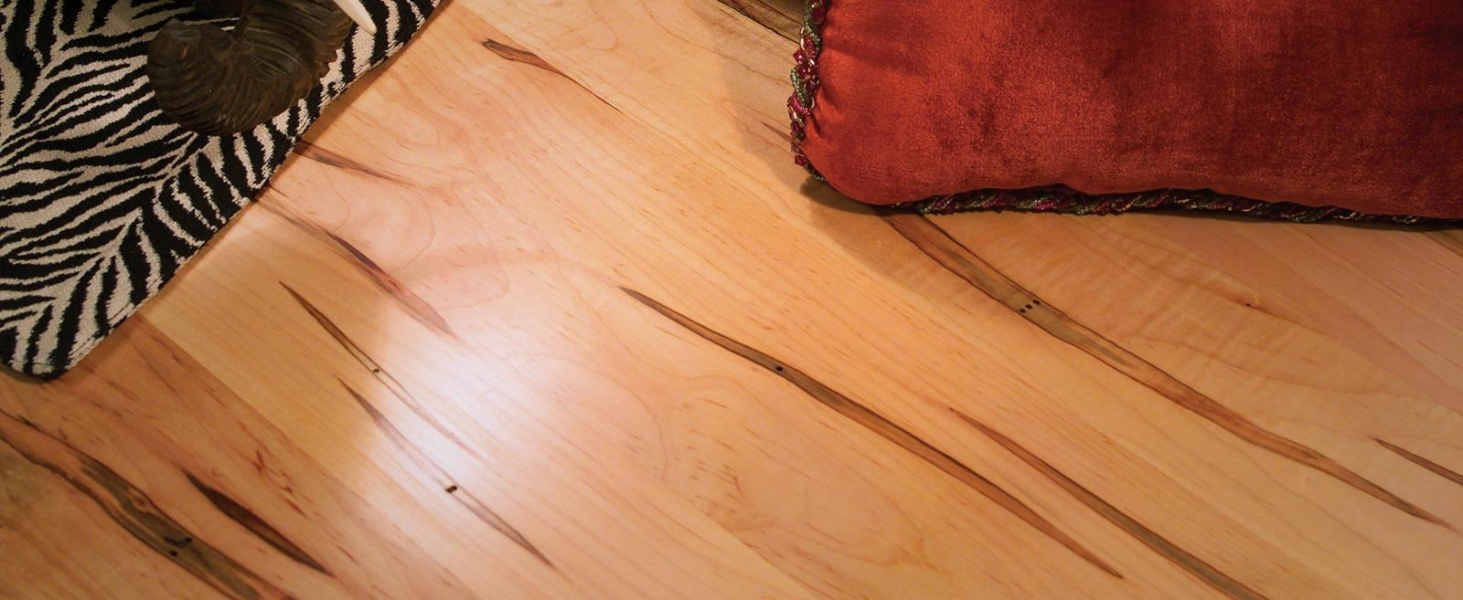 Rehmeyer Flooring makes some exotic looking wood floors - wormy maple